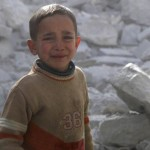 A boy cries as he stands amid rubble of collapsed buildings at a site hit by what activists said was a barrel bomb dropped by forces loyal to Syrian President Bashar Assad in Aleppo March 6. (CNS photo/Hosam Katan, Reuters) (March 10, 2014)